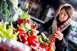 woman picking fresh healthy fruits and vegetables