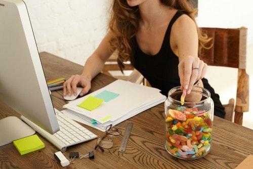 woman boredom eating at work