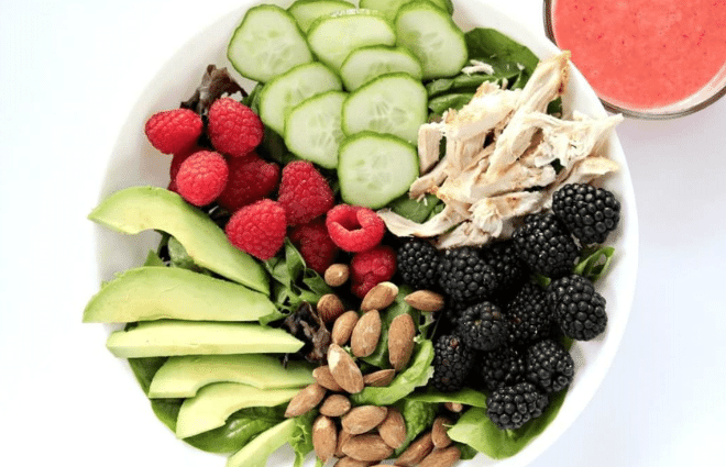 salad with berries, chicken, cucumbers, almonds and avocado