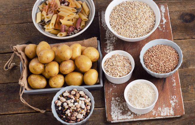 display of starchy carbs potatoes pasta grains legumes etc.