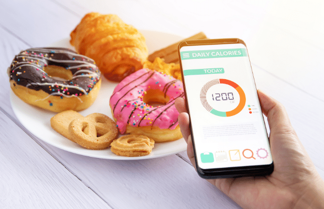 cell phone calorie counter with pastries, carbs, junk food