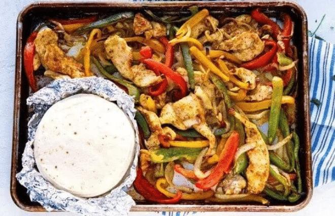 sheet pan chicken fajitas on sheet pan