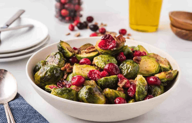 roasted brussels sprouts, cranberries and pecans in a bowl