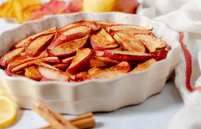baked apple slices in pastry dish