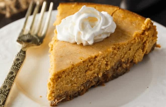 keto pumpkin cheesecake slice with whipped cream
